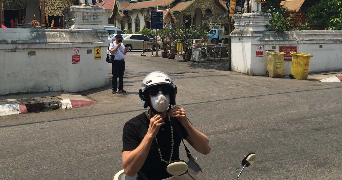 Wearing face masks to protect against the heavy smog air in Chiang Mai Thailand.